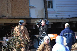 Fox 8 Cameraman in front of Nissen House
